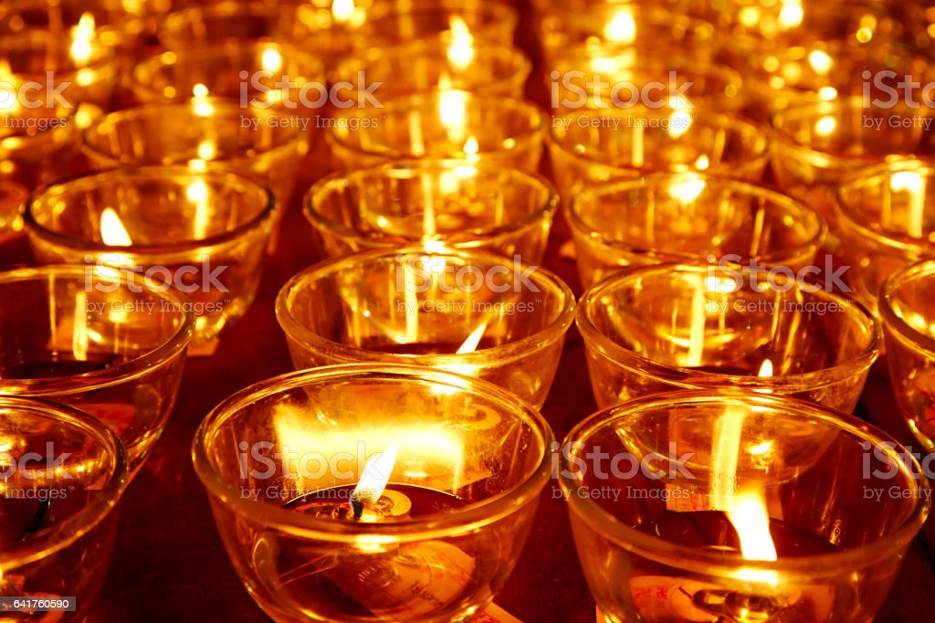 Burning candles in Buddhist temple stock photo