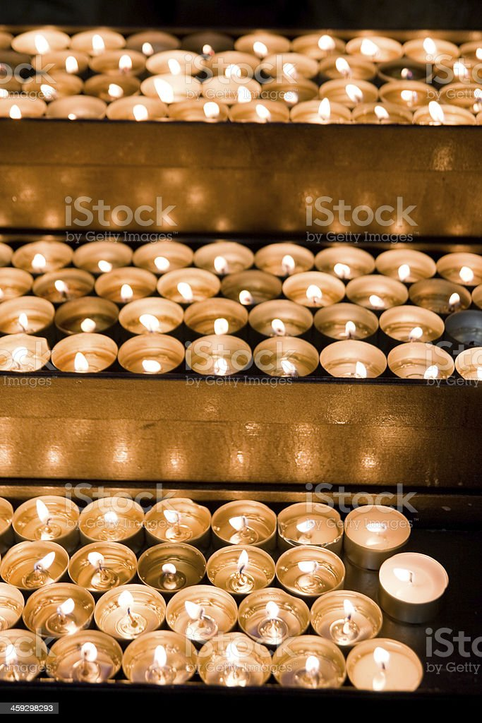 Burning candles in church royalty-free stock photo
