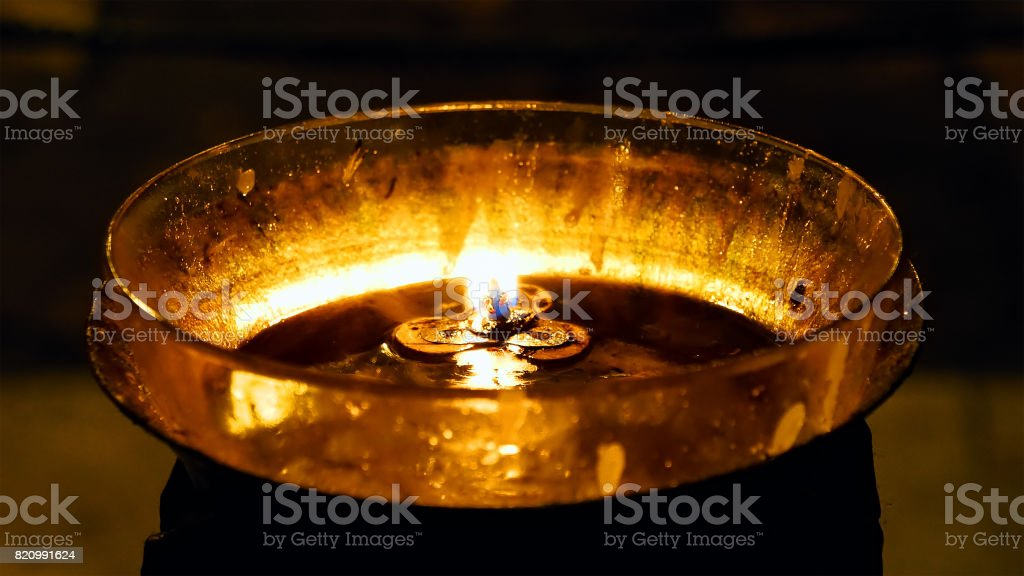 Burning candles in Holy Sepulcher Church stock photo