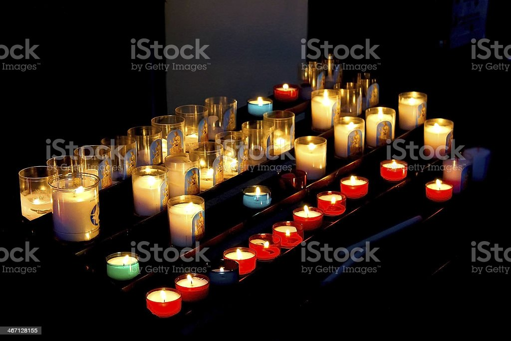 Burning candles in the cathedral of Bayeux stock photo