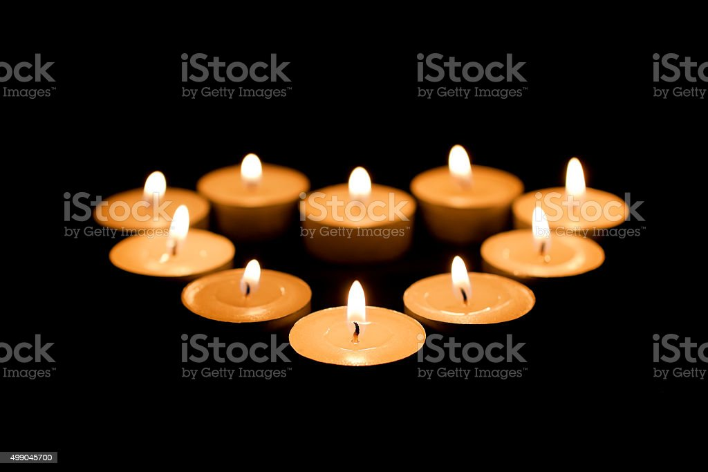 Burning candles in the form of heart stock photo
