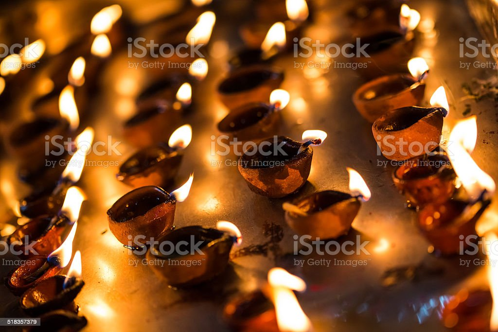 Burning candles in the Indian temple. stock photo