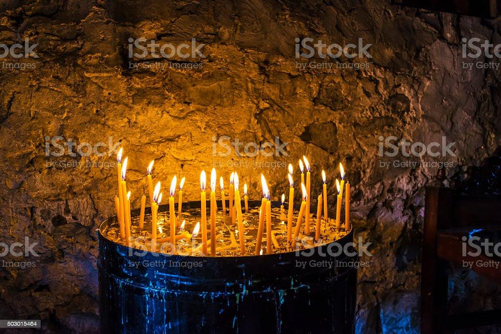 Burning Candles inside Stoned Monastery stock photo