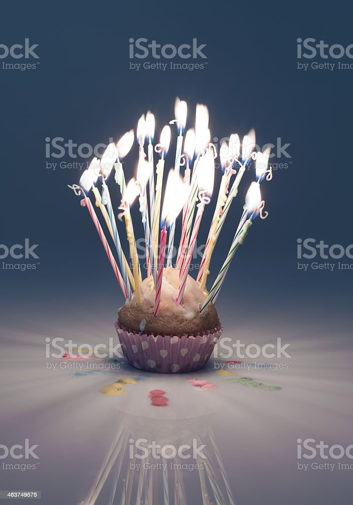 burning candles on a tartlet blue royalty-free stock photo