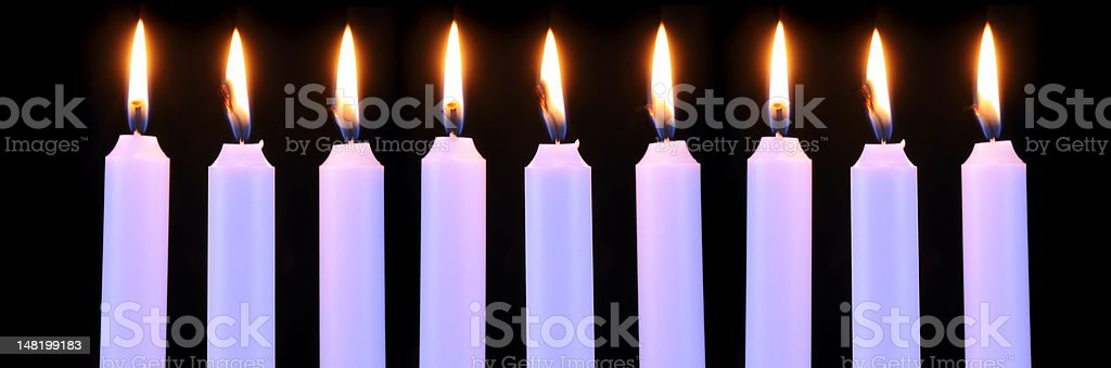 Burning Candles on Black Background royalty-free stock photo