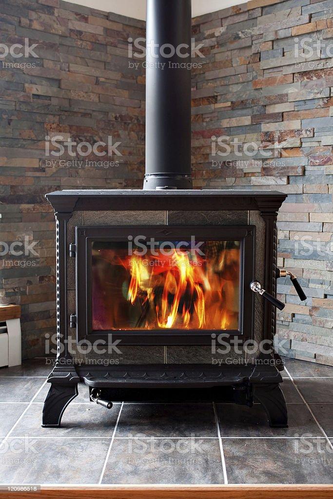 Burning Cast Iron Wood Stove Heating stock photo