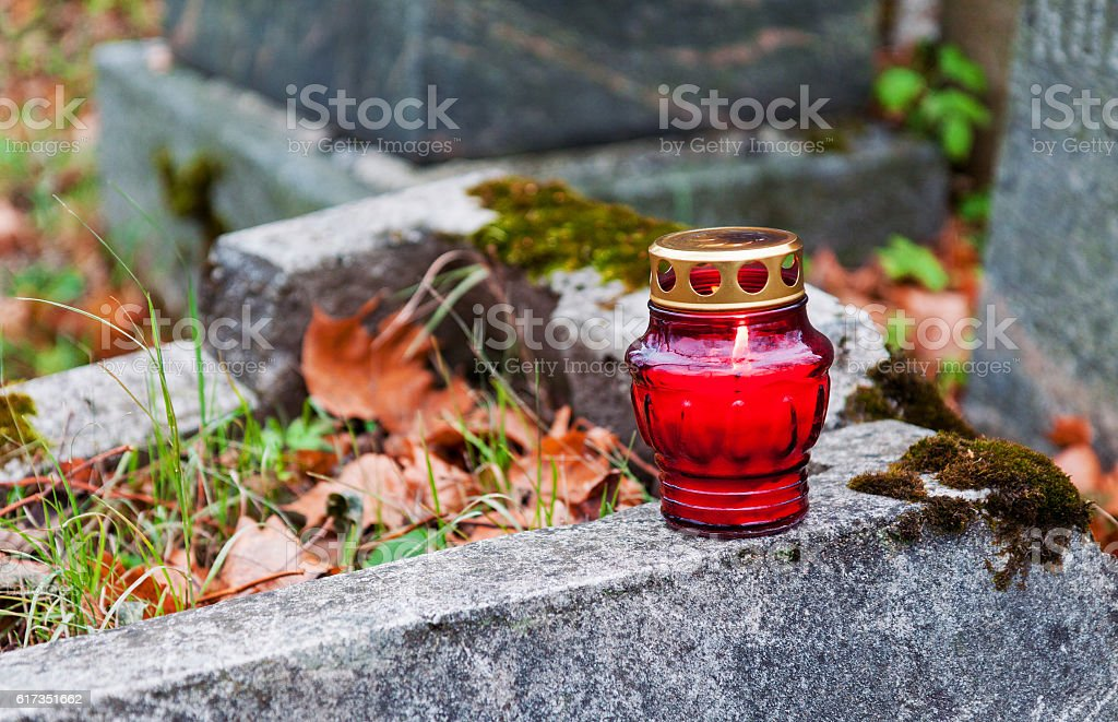 Burning cemetery candle stock photo