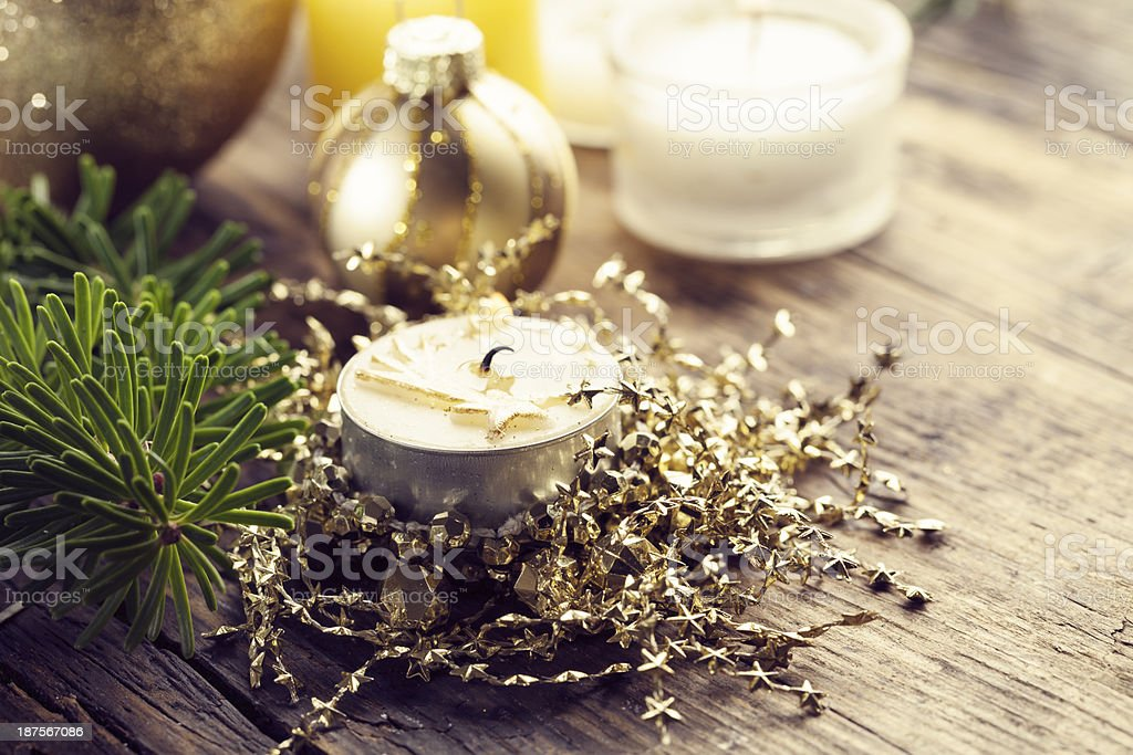 burning christmas candle branch of fir tree stock photo