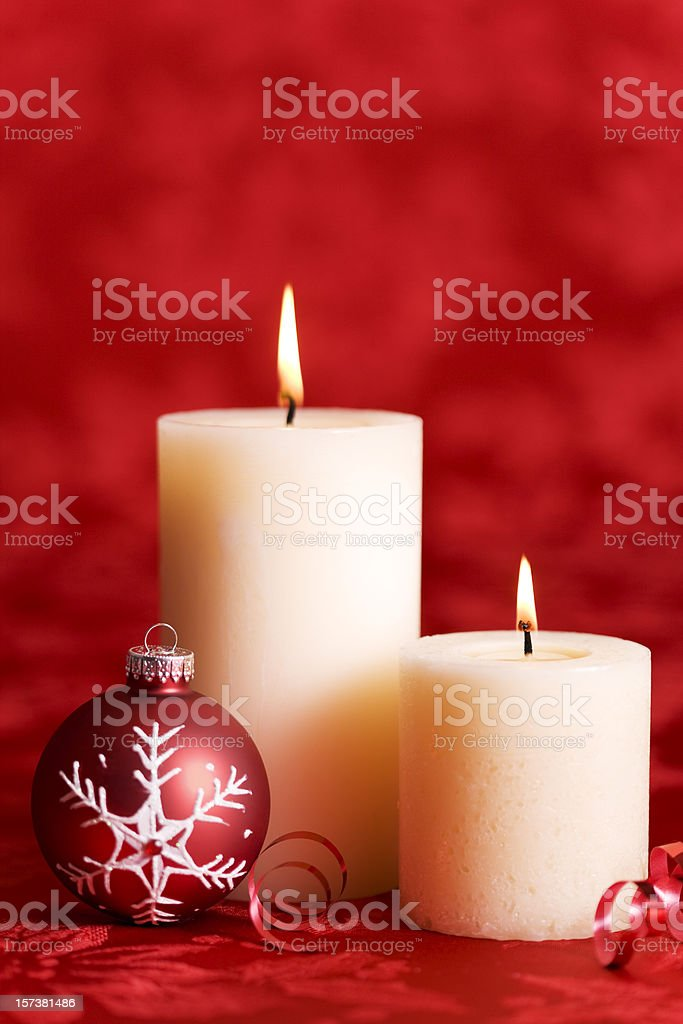 Burning Christmas Candles with Ornament on Red Background, Copy Space royalty-free stock photo