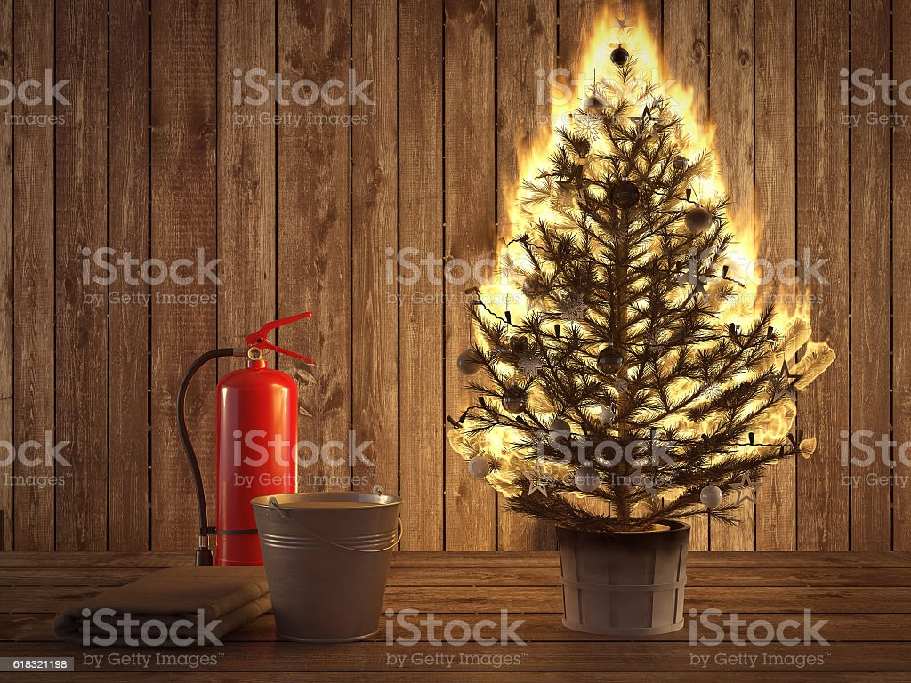 burning christmas tree with extinguisher and bucket beside. 3d rendering stock photo