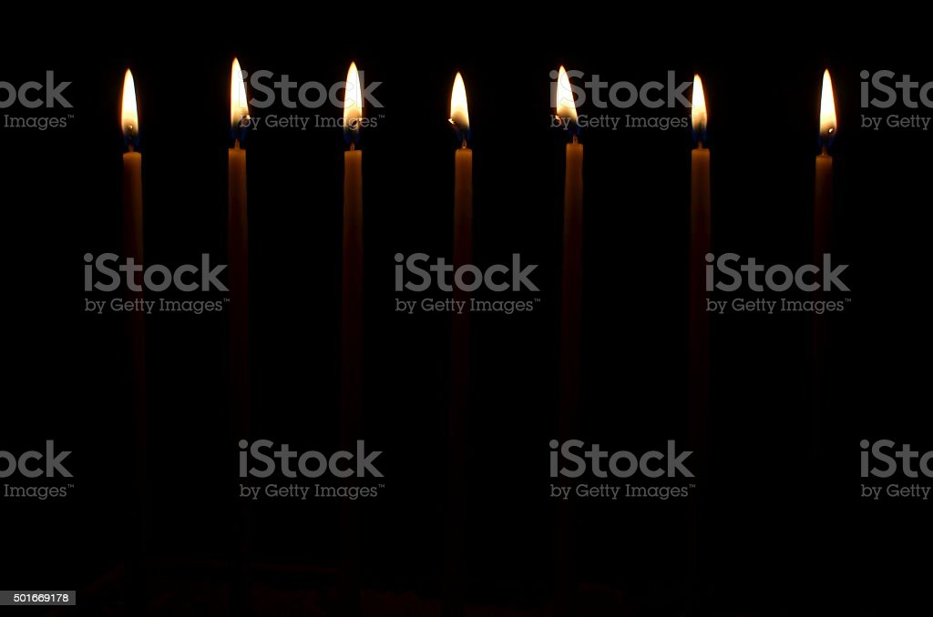 Burning church candles stock photo