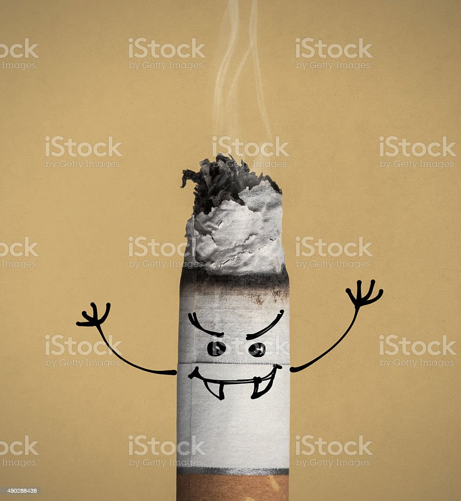 Burning cigarette and funny character stock photo