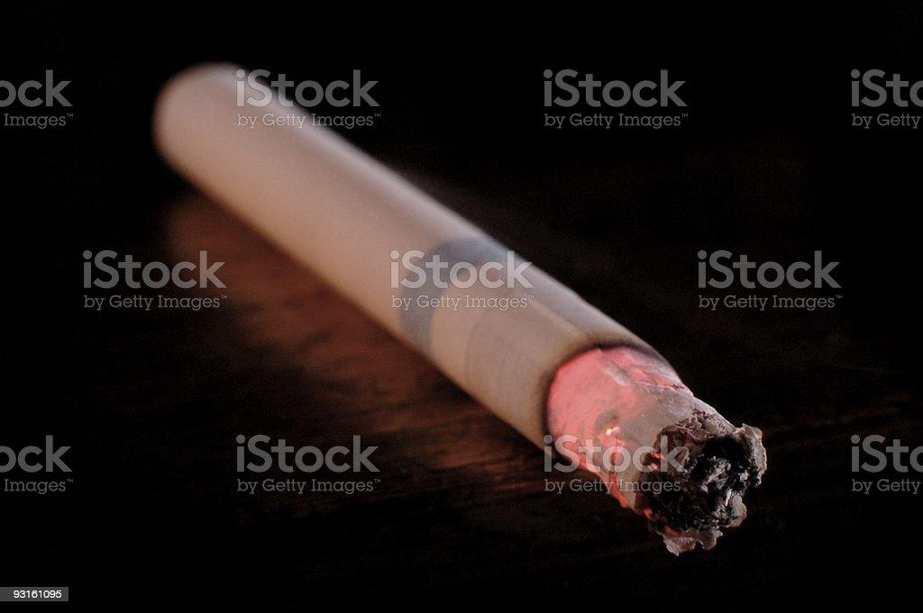 Burning Cigarette Macro royalty-free stock photo
