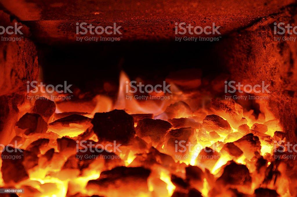 burning coal in a blast furnace stock photo