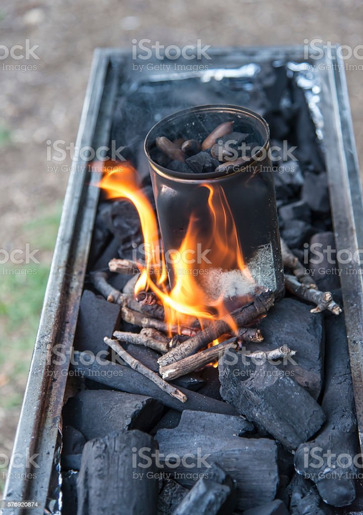 burning coals in a grill starter stock photo