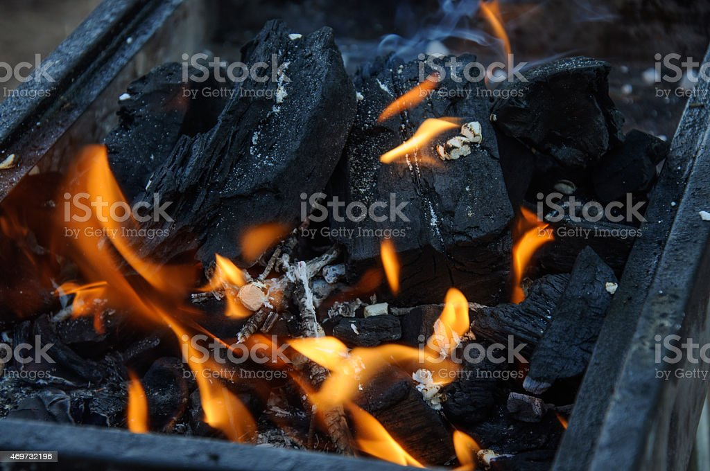 Burning coals stock photo