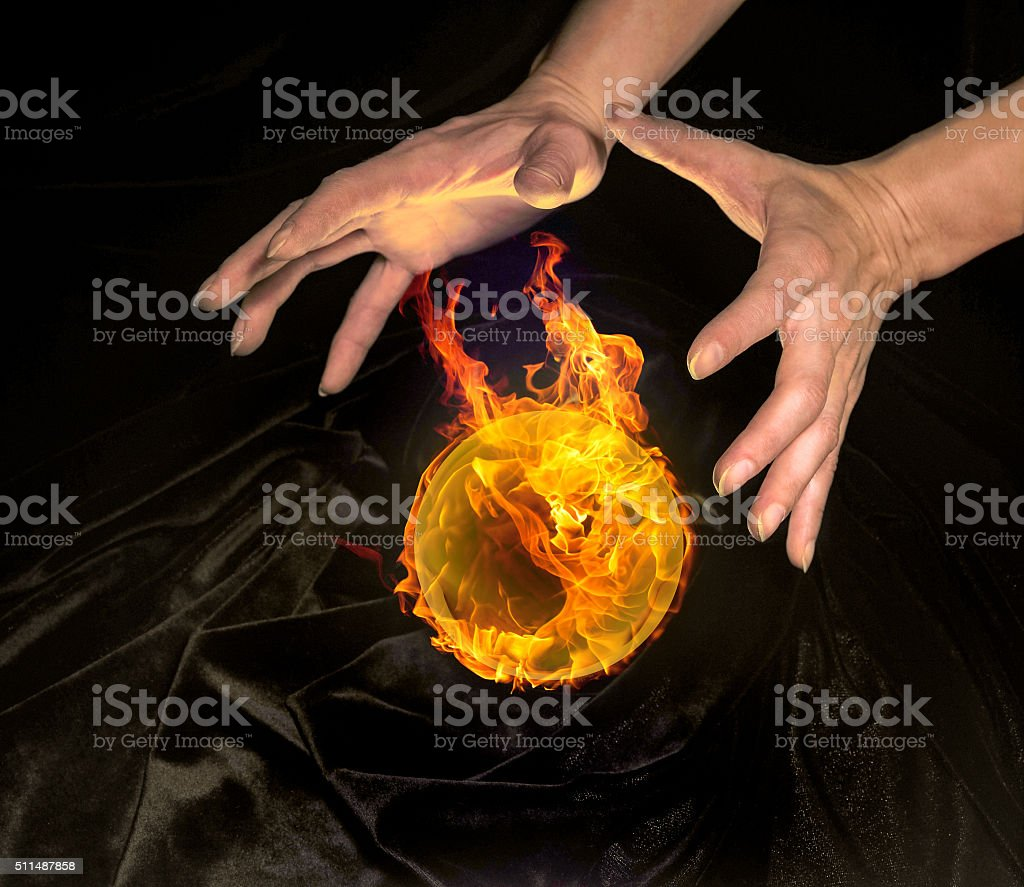 burning crystal ball and hands stock photo