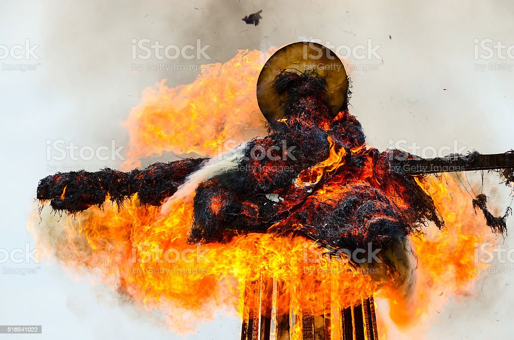 Burning down scarecrow of Shrovetide stock photo