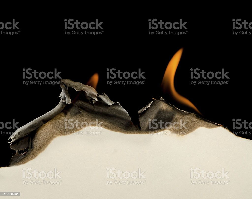 Burning edge of paper stock photo