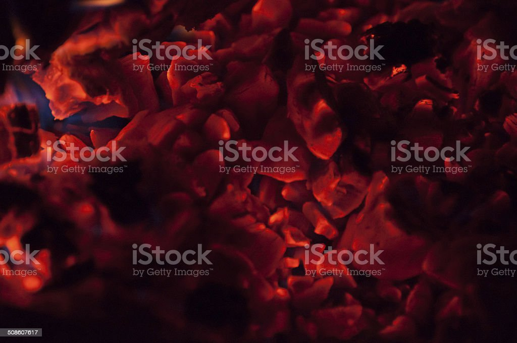 Burning embers in the dark royalty-free stock photo