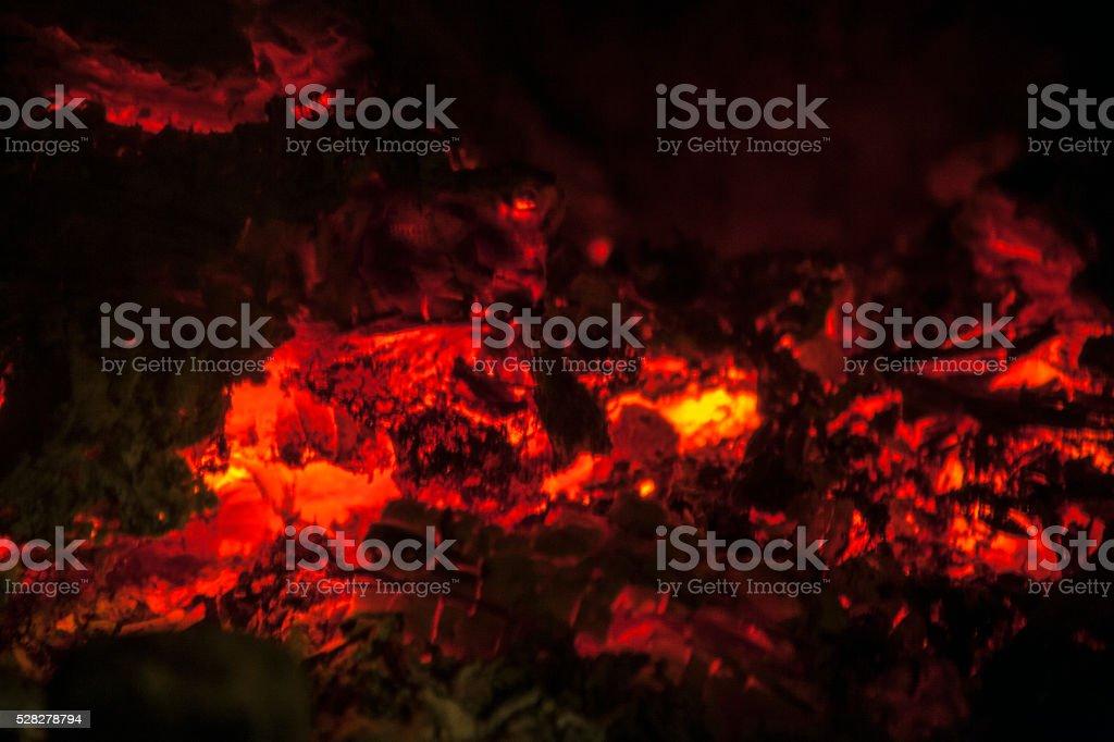 Burning embers in the dark stock photo