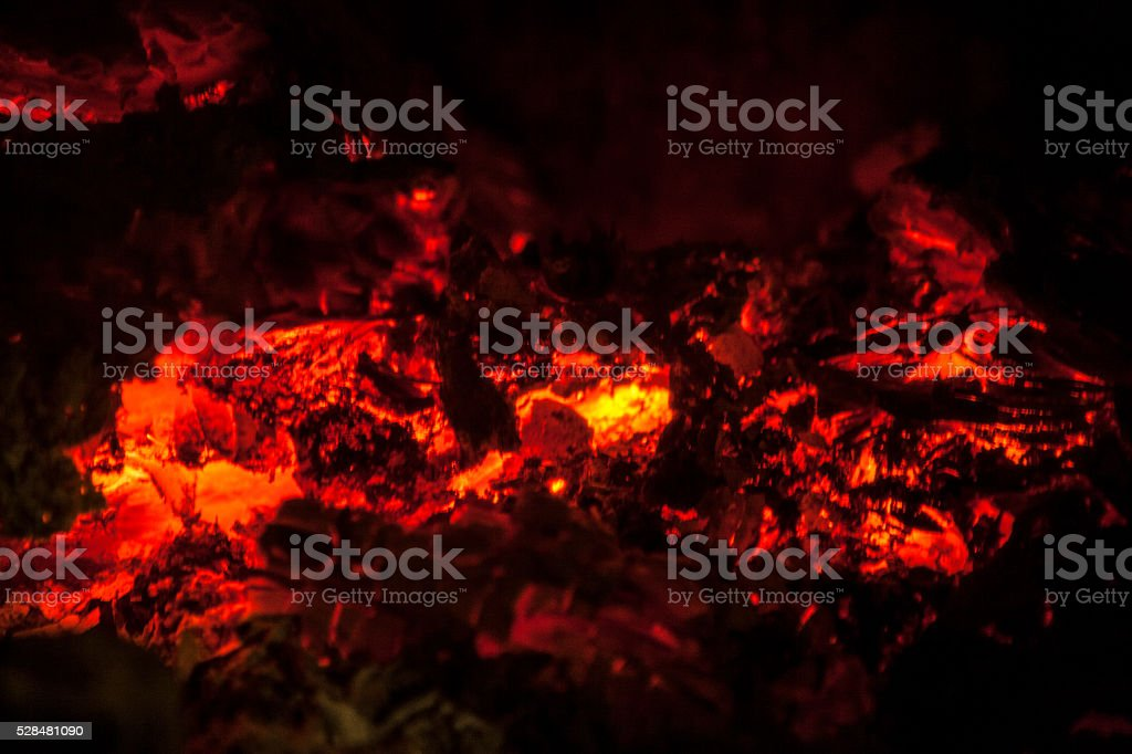 Burning embers in the dark stock photo