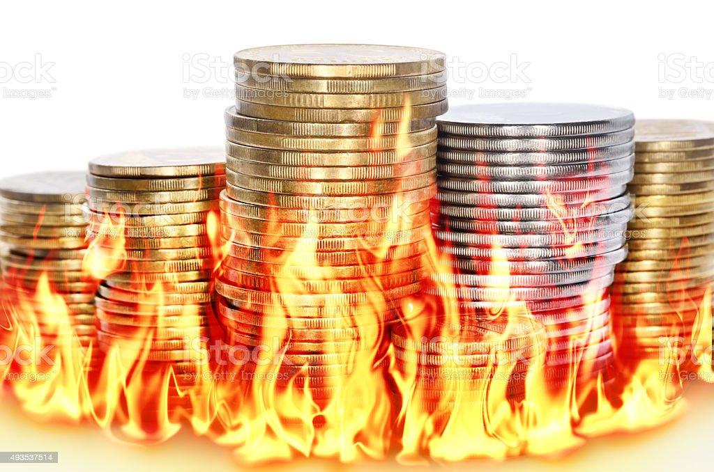 Burning financial savings isolated on white background stock photo