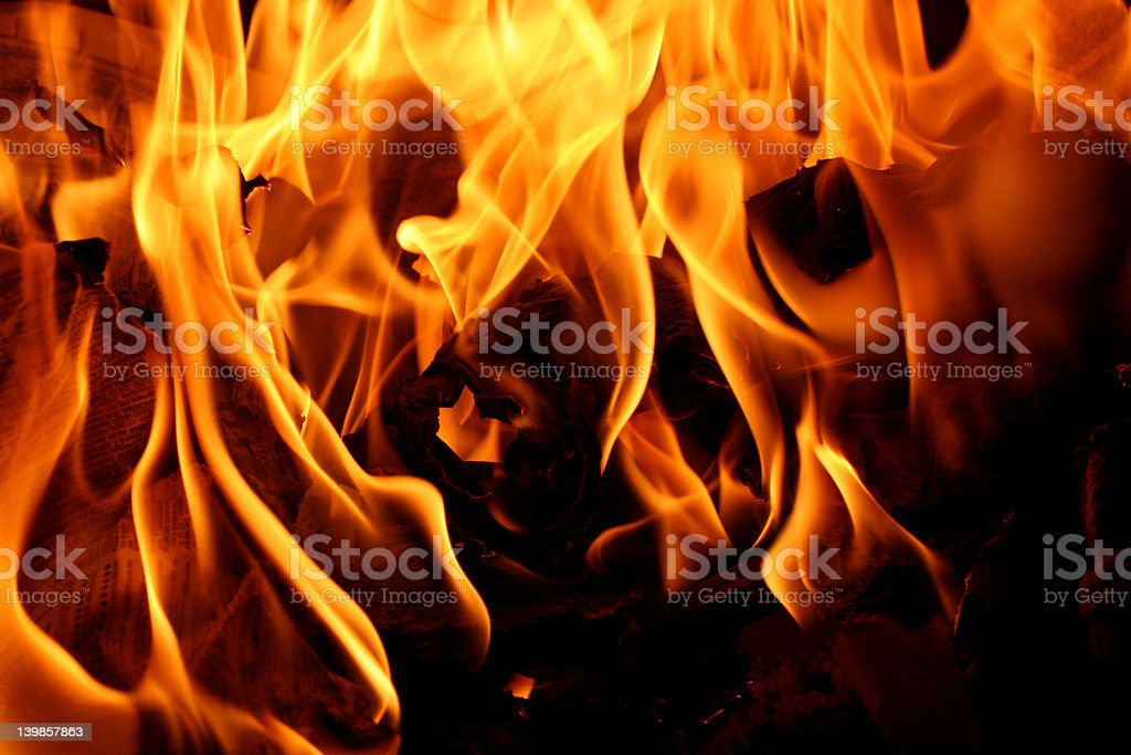 Burning fire with flames in fireplace, close-up royalty-free stock photo