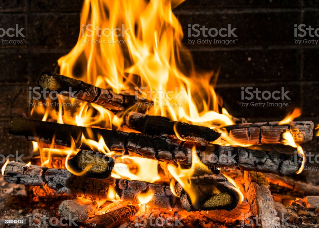 Burning firewood in the fireplace close up, BBQ stock photo