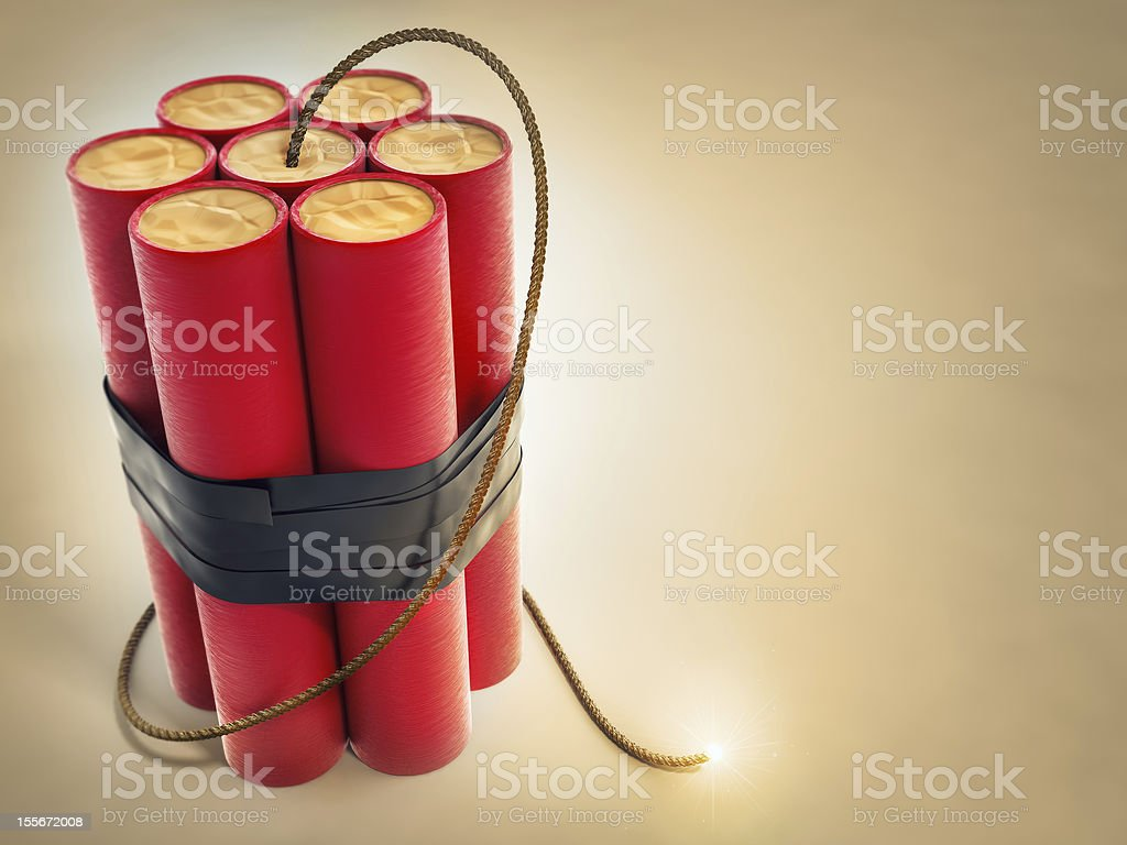burning fuse with dynamite explosives stock photo