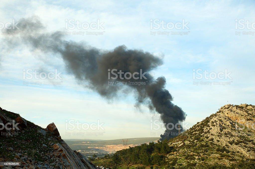Burning garbage heap of smoke stock photo