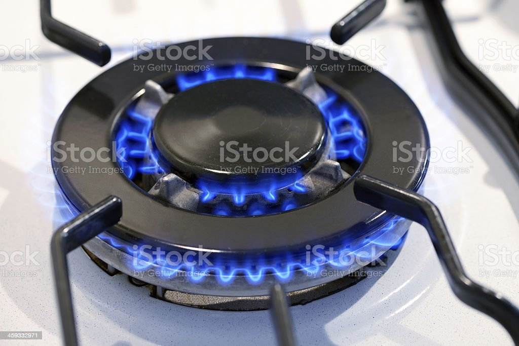 Burning gas ring on a stove top stock photo