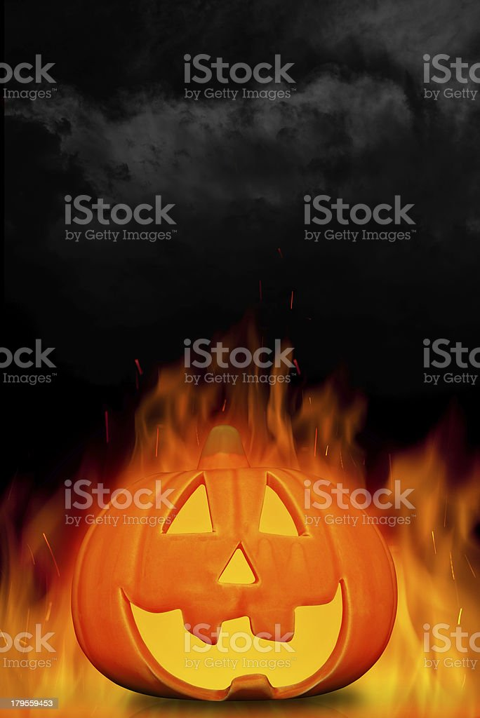 Burning halloween pumpkin with dark background royalty-free stock photo