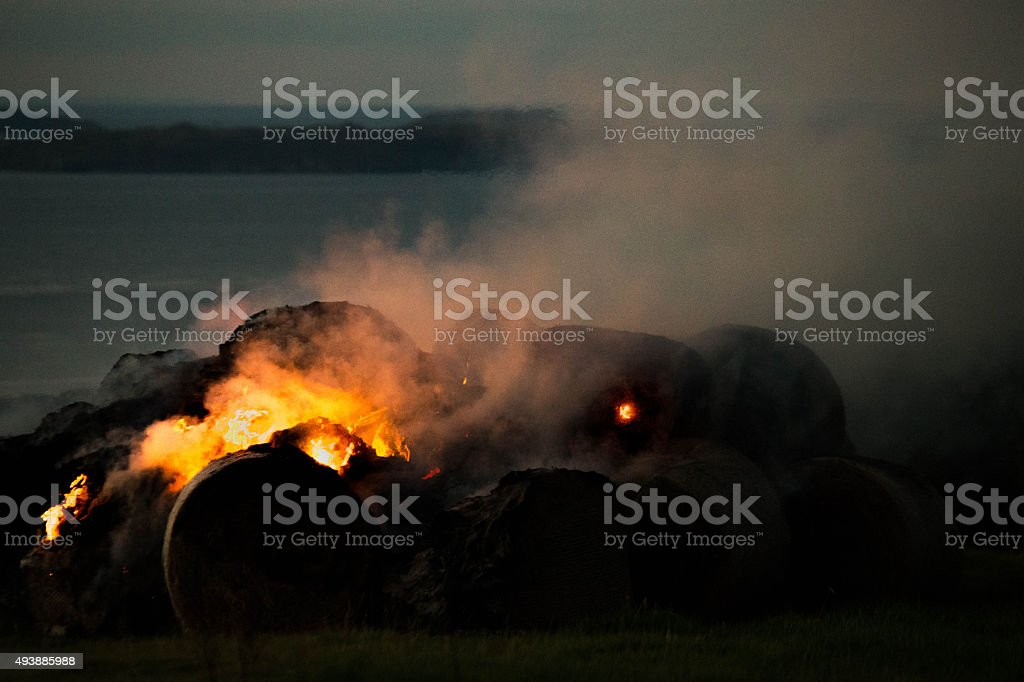 burning hay bales stock photo
