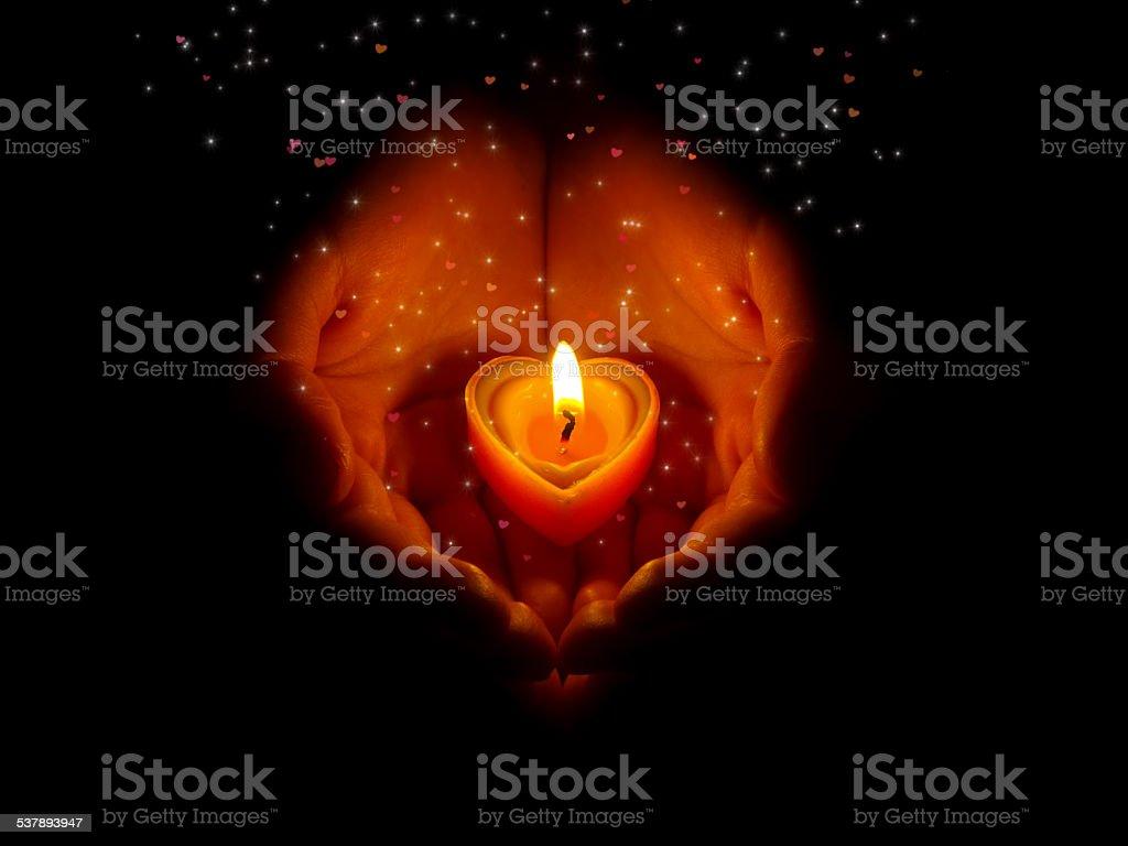 burning heart on hands. stock photo