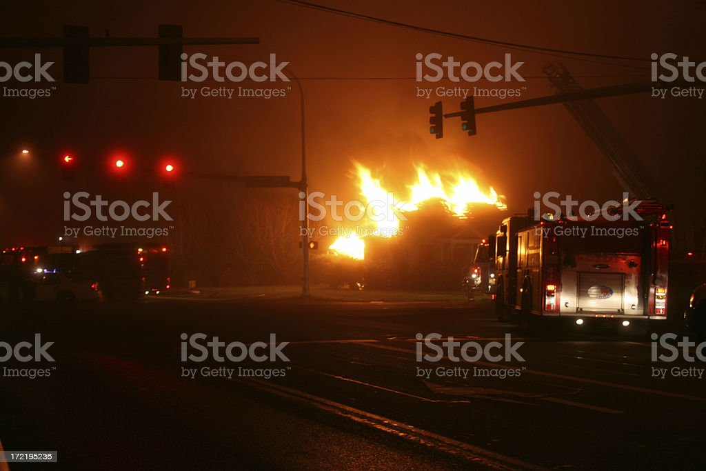 Burning home in Orting Valley stock photo