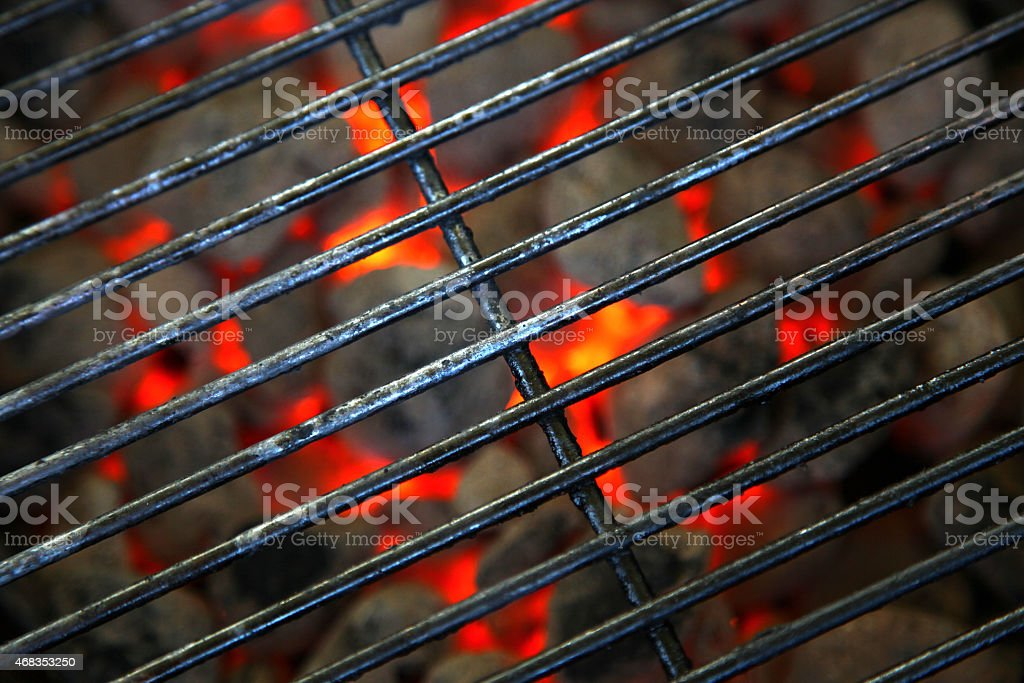burning hot grill ready for barbecue stock photo