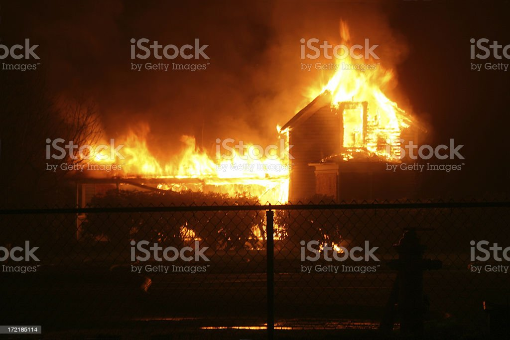 Burning House in Orting Valley at night stock photo