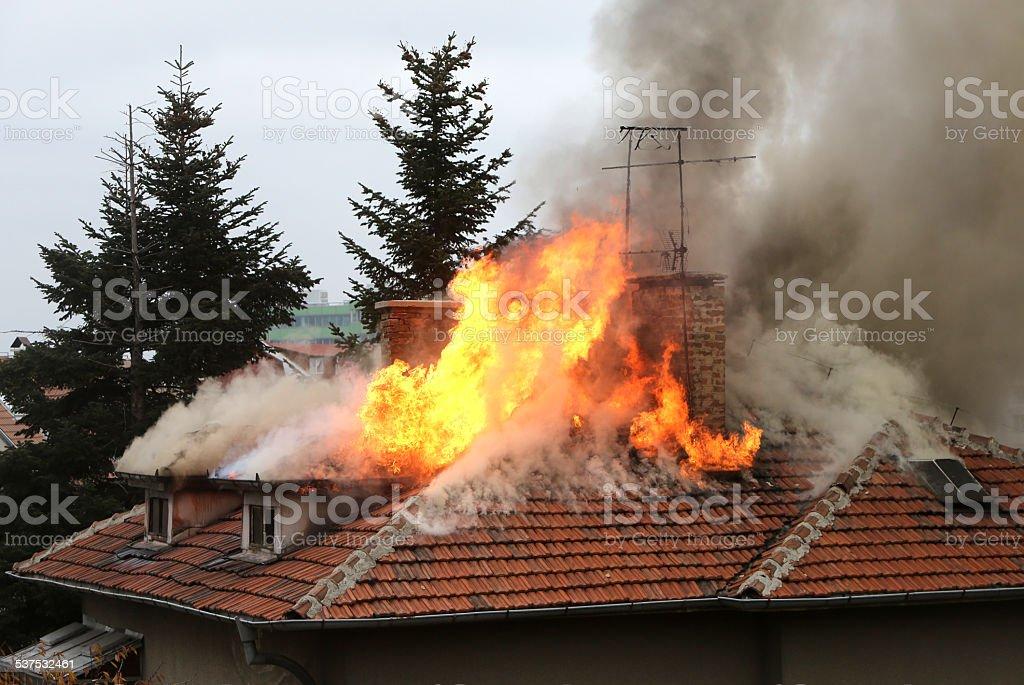 Burning house roof stock photo