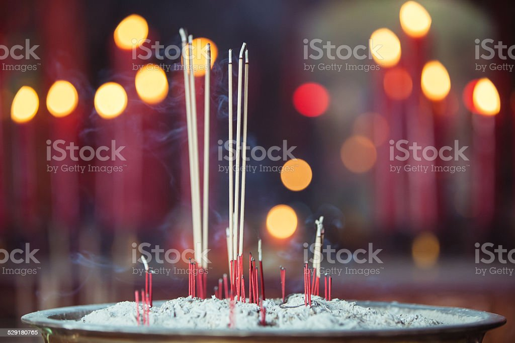 Burning incense in Chinese temple stock photo