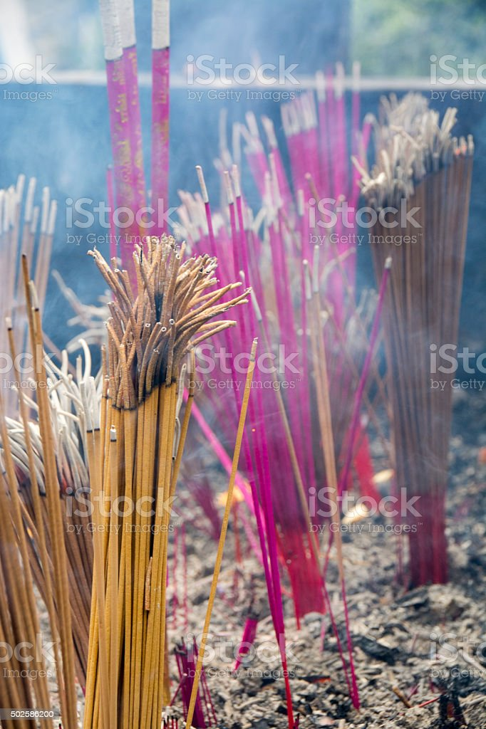 Burning incense in temple stock photo