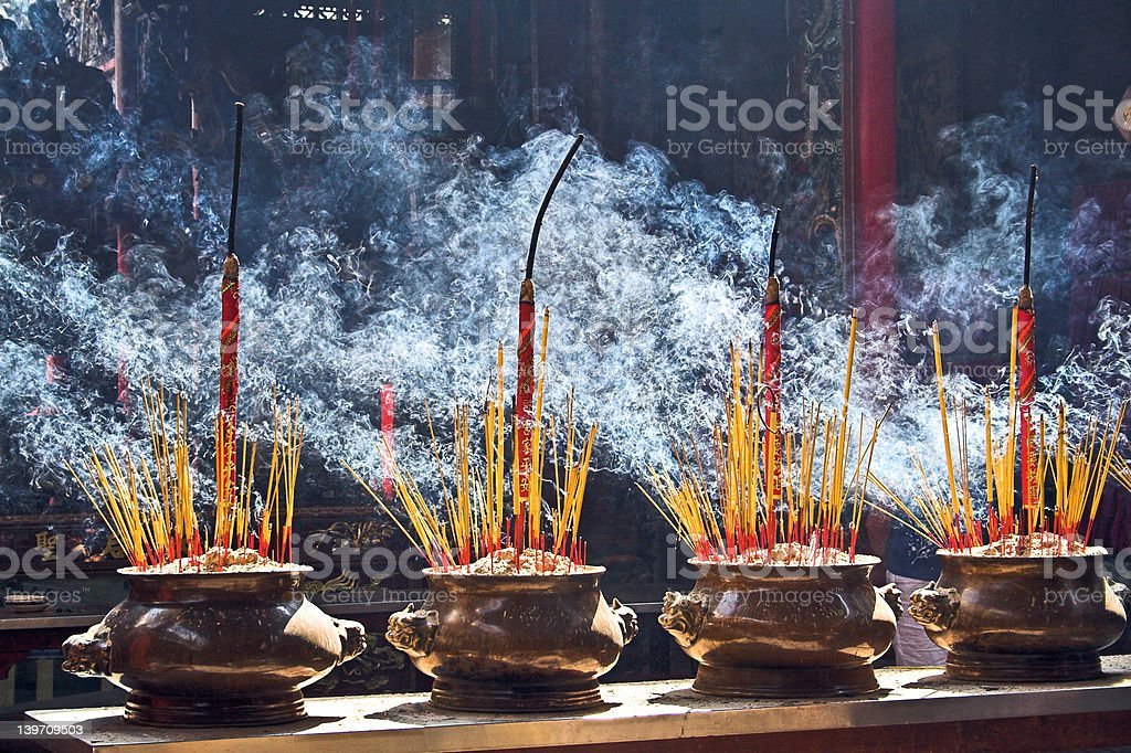 Burning incenses stock photo