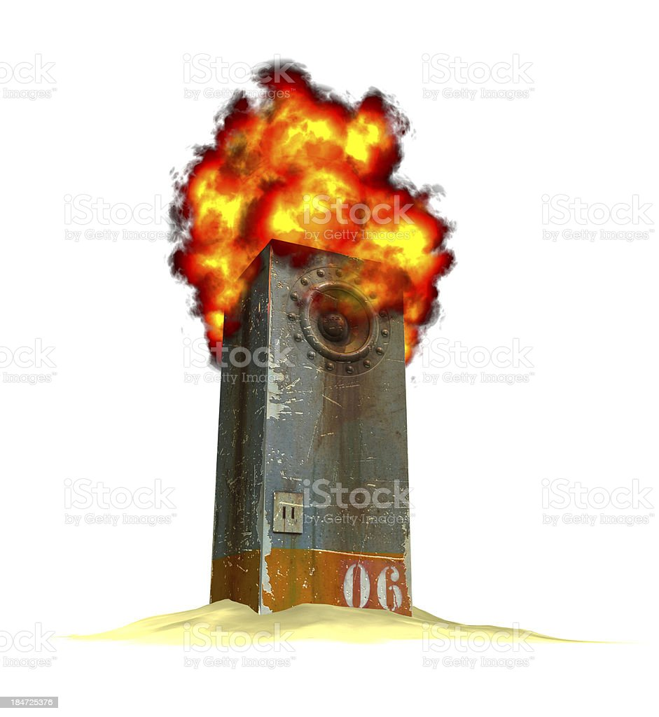 burning industrial speaker sound-system on a pile of sand stock photo