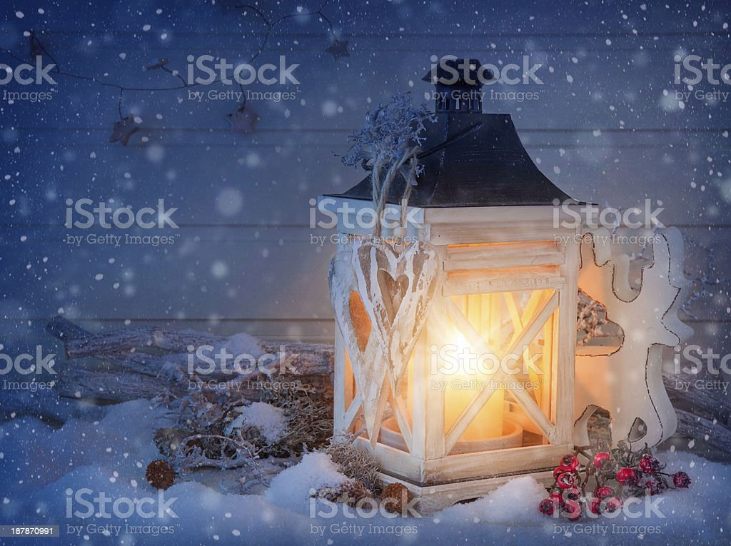 Burning lantern and christmas decoration stock photo