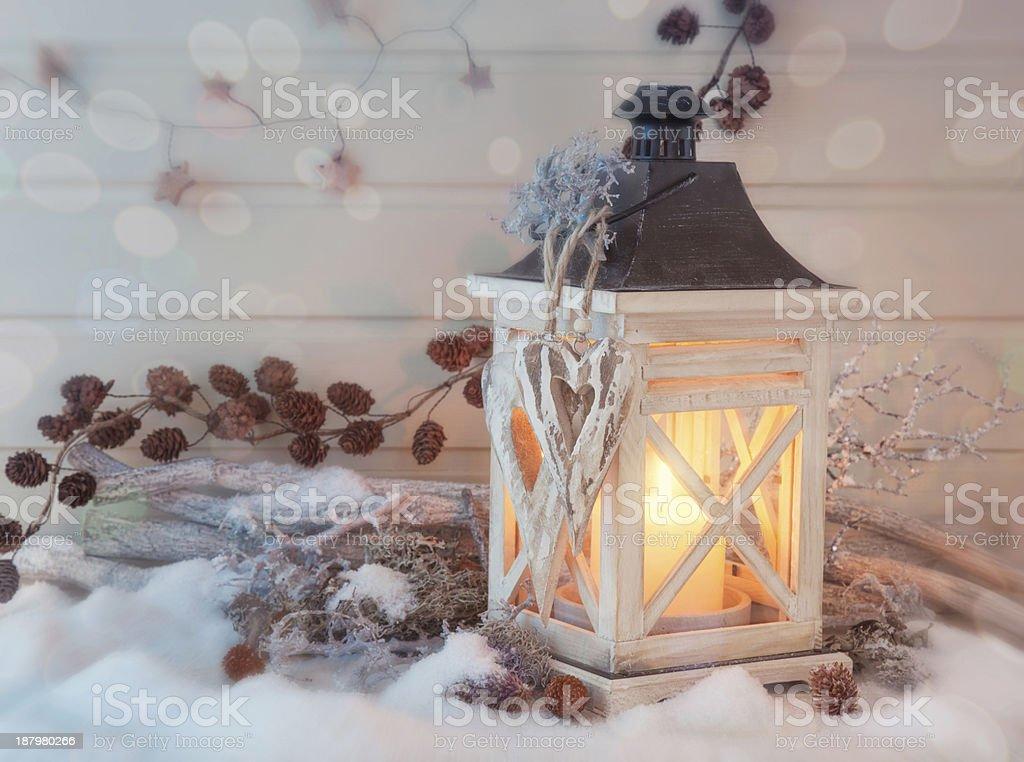 Burning lantern and christmas decoration royalty-free stock photo