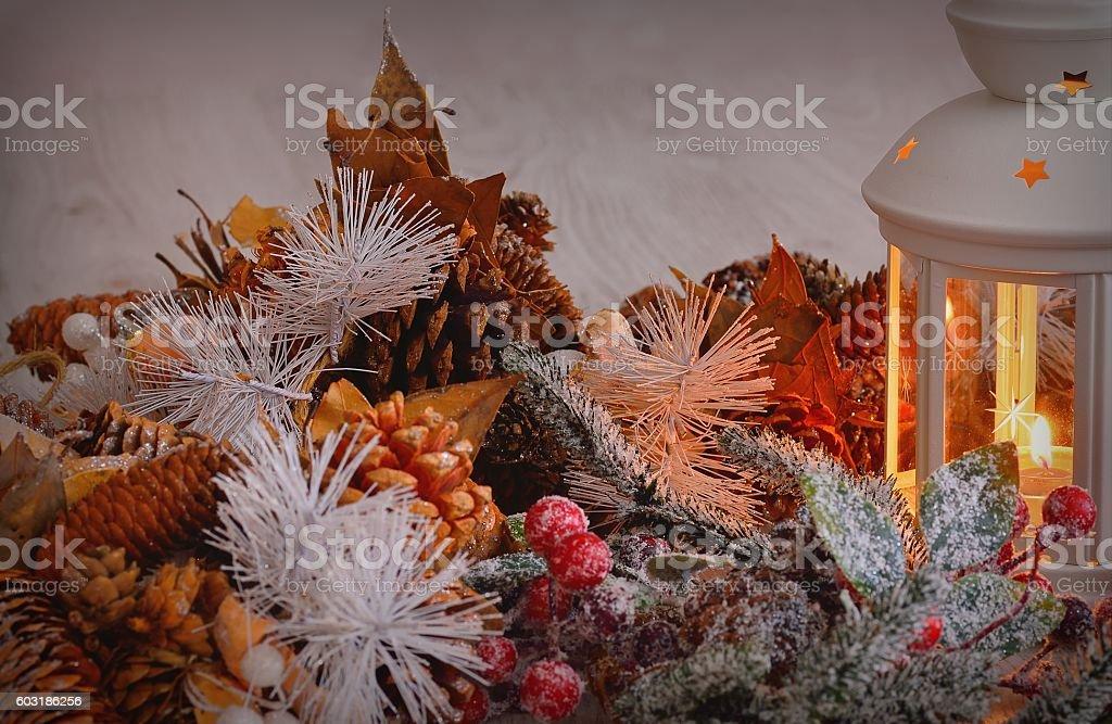 Burning lantern with christmas decorations stock photo