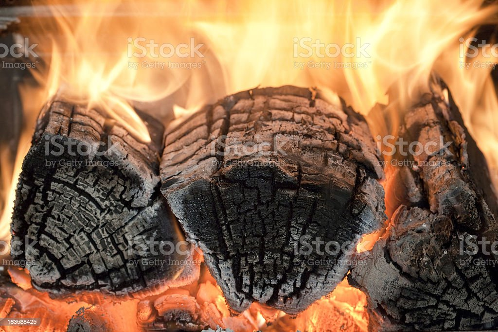 Burning logs in a wood burning stove stock photo