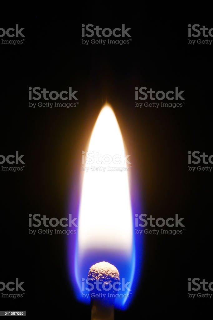 Burning match in the dark stock photo