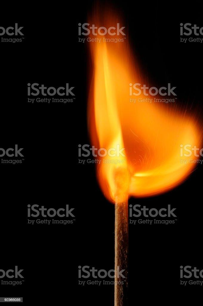Burning matchstick creates beautifully bowl shaped flame royalty-free stock photo