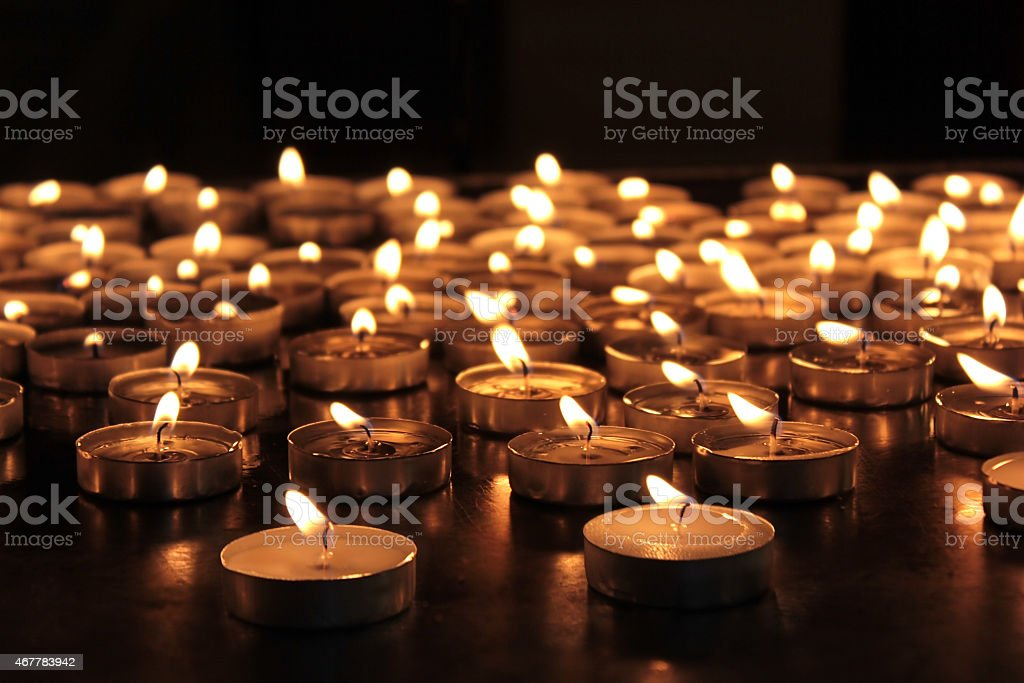 burning memorial candles stock photo